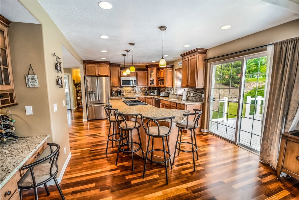 Beautifully finished hardwood floors in the kitchen. Dark wood adds value to any home.