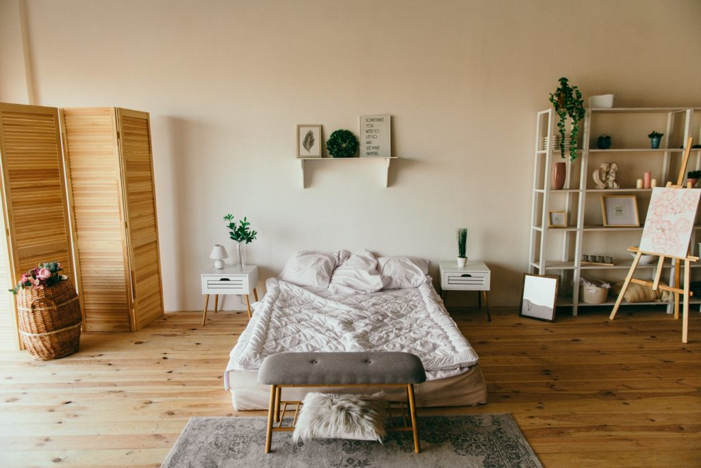 Minimalist room with bare hardwood floor adds value ascetically and will last a lifetime.