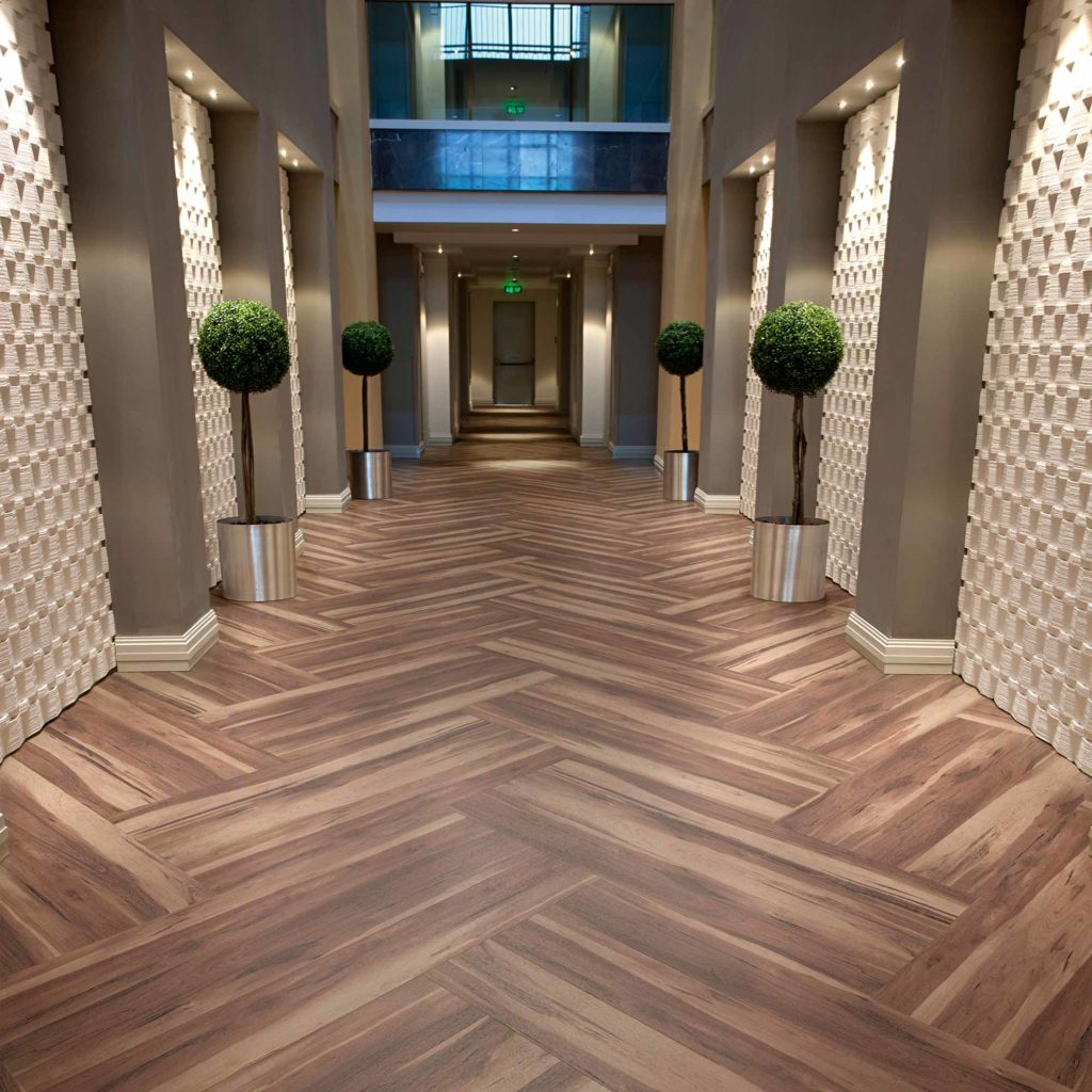 Hospitality floorin example of installled luxury vinyl tiles LVT.